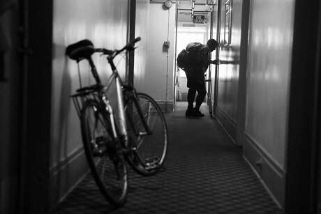 "Crosby Hotel resident Grafton ""Wes"" Jones knocks on fellow resident Anna Hobbs' door in San Francisco, Calif., on Monday, November 14, 2016. Jones and Hobbs have both lived in the Tenderloin SRO for the past 10 years."