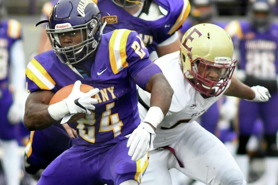 UAlbany's Elijah Ibitokun-Hanks, left, gains yards as Elon's Warren Messer defends during their football game on Saturday, Oct. 29, 2016, at Casey Stadium in Albany, N.Y. (Cindy Schultz / Times Union) Photo: Cindy Schultz / Albany Times Union