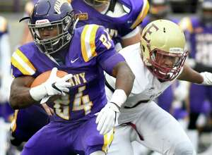 UAlbany's Elijah Ibitokun-Hanks, left, gains yards as Elon's Warren Messer defends during their football game on Saturday, Oct. 29, 2016, at Casey Stadium in Albany, N.Y. (Cindy Schultz / Times Union)
