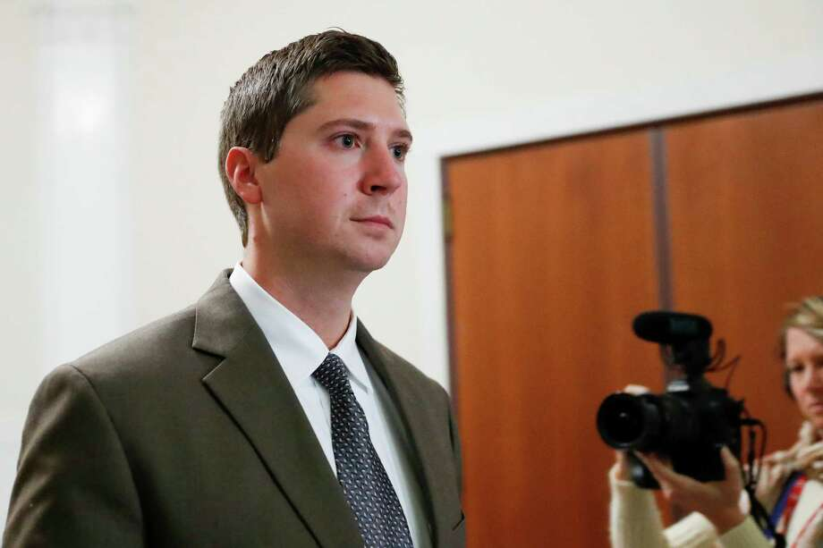 FILE – In this Nov. 10, 2016, file photo, former University of Cincinnati police officer Ray Tensing leaves court after the second day of jury deliberations in his murder trial in Cincinnati. Hamilton County, Ohio, Prosecutor Joe Deters scheduled a Tuesday, Nov. 22, 2016, news conference to discuss the prosecution of Tensing, after a jury deadlocked and a judge declared a mistrial Nov. 12, 2016, on charges of murder and voluntary manslaughter in the fatal July 2015 shooting of black motorist Sam DuBose. (AP Photo/John Minchillo, File) Photo: John Minchillo, STF / AP