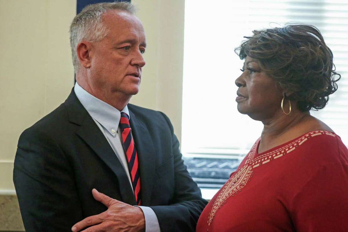 FILE Â?- In this Nov. 1, 2016, file photo, Hamilton County Prosecutor Joe Deters, left, speaks with Audrey DuBose, right, the mother of Sam DuBose, in a courtroom at the Hamilton County Courthouse in Cincinnati. Hamilton County, Ohio, Prosecutor Joe Deters scheduled a Tuesday, Nov. 22, 2016, news conference to discuss the prosecution of white former University of Cincinnati police officer Ray Tensing, after a jury deadlocked and a judge declared a mistrial Nov. 12, 2016, on charges of murder and voluntary manslaughter in the fatal July 2015 shooting of black motorist Sam DuBose. (Carrie Cochran/The Cincinnati Enquirer via AP, Pool, File)