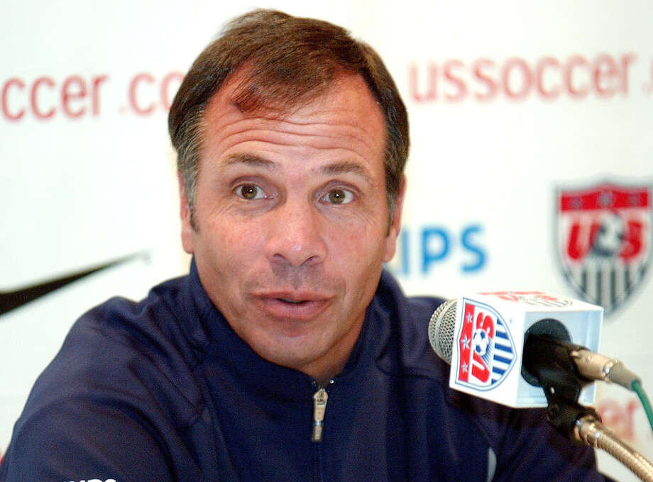 FILE - In this June 12, 2002, file photo, Bruce Arena, head coach of the U.S soccer team, addresses a questions during a news conference at the team's hotel in Seoul, South Korea, in advance of a World Cup match against Poland. Arena is returning to coach the U.S. national team, a decade after he was fired.  The winningest coach in American national team history, Arena took over Tuesday, Nov. 22, 2016, one day after Jurgen Klinsmann was fired.  (AP Photo/Tony Gutierrez, File) Photo: TONY GUTIERREZ, STF / 2002 AP