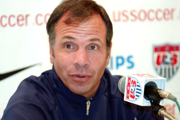 FILE - In this June 12, 2002, file photo, Bruce Arena, head coach of the U.S soccer team, addresses a questions during a news conference at the team's hotel in Seoul, South Korea, in advance of a World Cup match against Poland. Arena is returning to coach the U.S. national team, a decade after he was fired.  The winningest coach in American national team history, Arena took over Tuesday, Nov. 22, 2016, one day after Jurgen Klinsmann was fired.  (AP Photo/Tony Gutierrez, File)