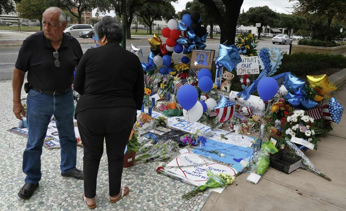 Ignacio Vidaurri Jr. and his wife Maria pay their respects for slain police officer Marconi at make-shift memorial at the San Antonio Police Headquarters on Tuesday, November 22, 2016.