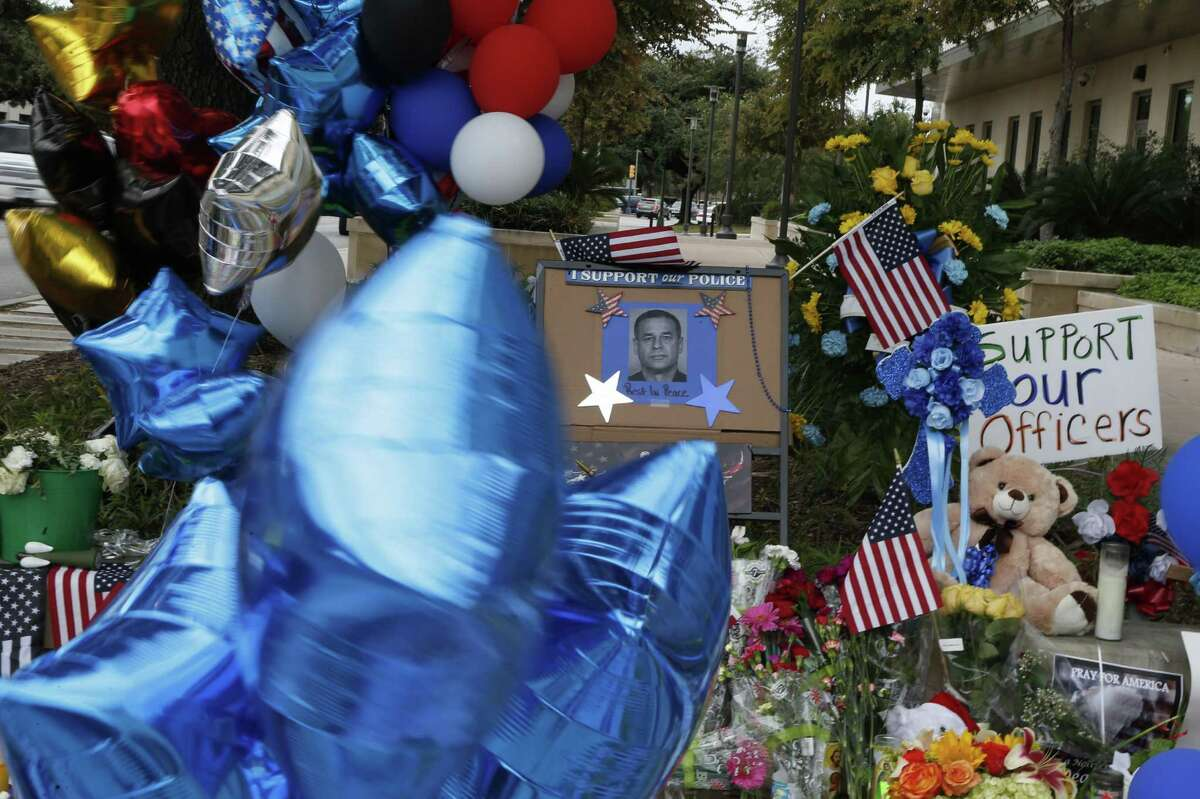 Detail of make-shift memorial at the San Antonio Police Headquarters on Tuesday, November 22, 2016.