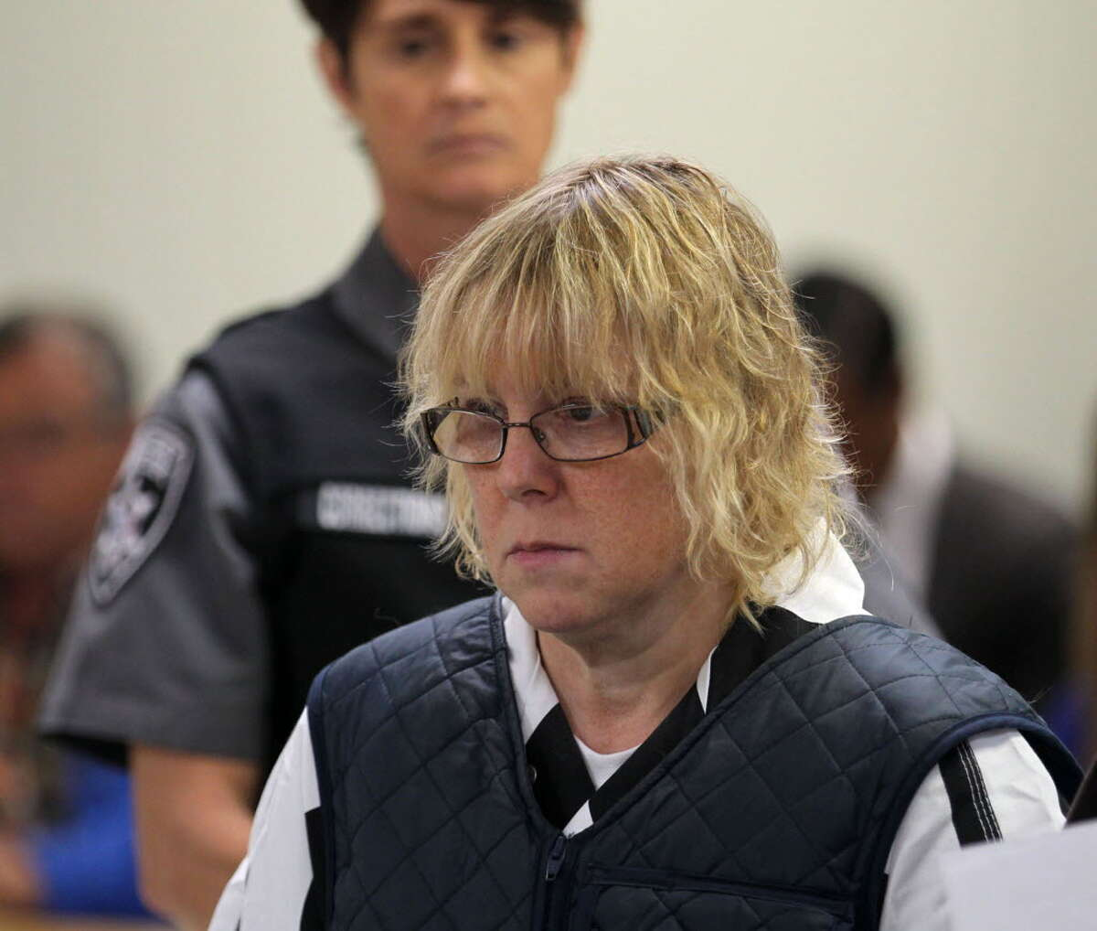 In this June 15, 2015, file photo, Joyce Mitchell appears before Judge Mark Rogers in Plattsburgh (N.Y.) City Court for a hearing. She is charged with helping Richard Matt and David Sweat escape from the Clinton Correctional Facility on June 6. (G.N. Miller/NY Post via AP, Pool, File)
