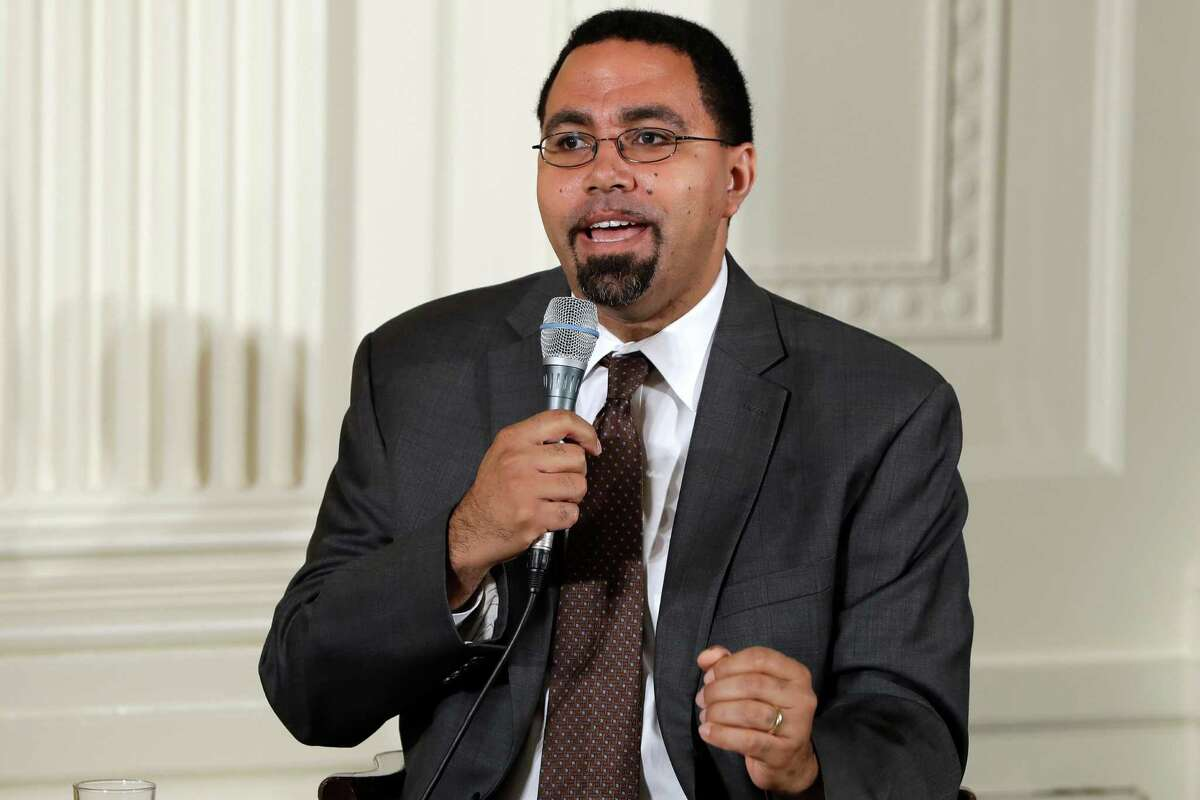 FILE - In this July 19, 2016, file photo, Education Secretary John B. King, Jr., speaks on a panel with first lady Michelle Obama to college-bound students participating in the Reach Higher initiative's third annual Beating the Odds event in the East Room of the White House in Washington. King is urging governors and school leaders in states where student paddling is allowed to end a practice he said would be considered ?