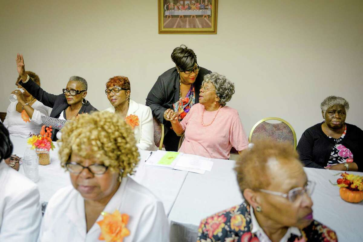 Tanya Debose (center), the honorary mayor of Independence Heights, speaks with Vivian Green at a Thanksgiving meal for seniors at Providence Missionary Baptist Church, Tuesday, Nov. 22, 2016.