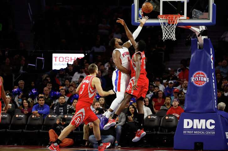 The Rockets' Clint Capela, right, held his own against Andre Drummond on Monday night with 15 points and 12 rebounds to the Pistons center's 13 and 16.