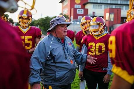 Lincoln High School football coach Phil Ferrigno (center) talks to his football team during practice at Lincoln High School, in San Francisco, California, on Tuesday November 22, 2016.