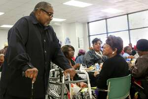 Sandra Massie Hines, center,  convinced food bank officials to spend one morning a month in Sunnyside, where more than 600 residents receive nutritional items at the Multi-Service Center.