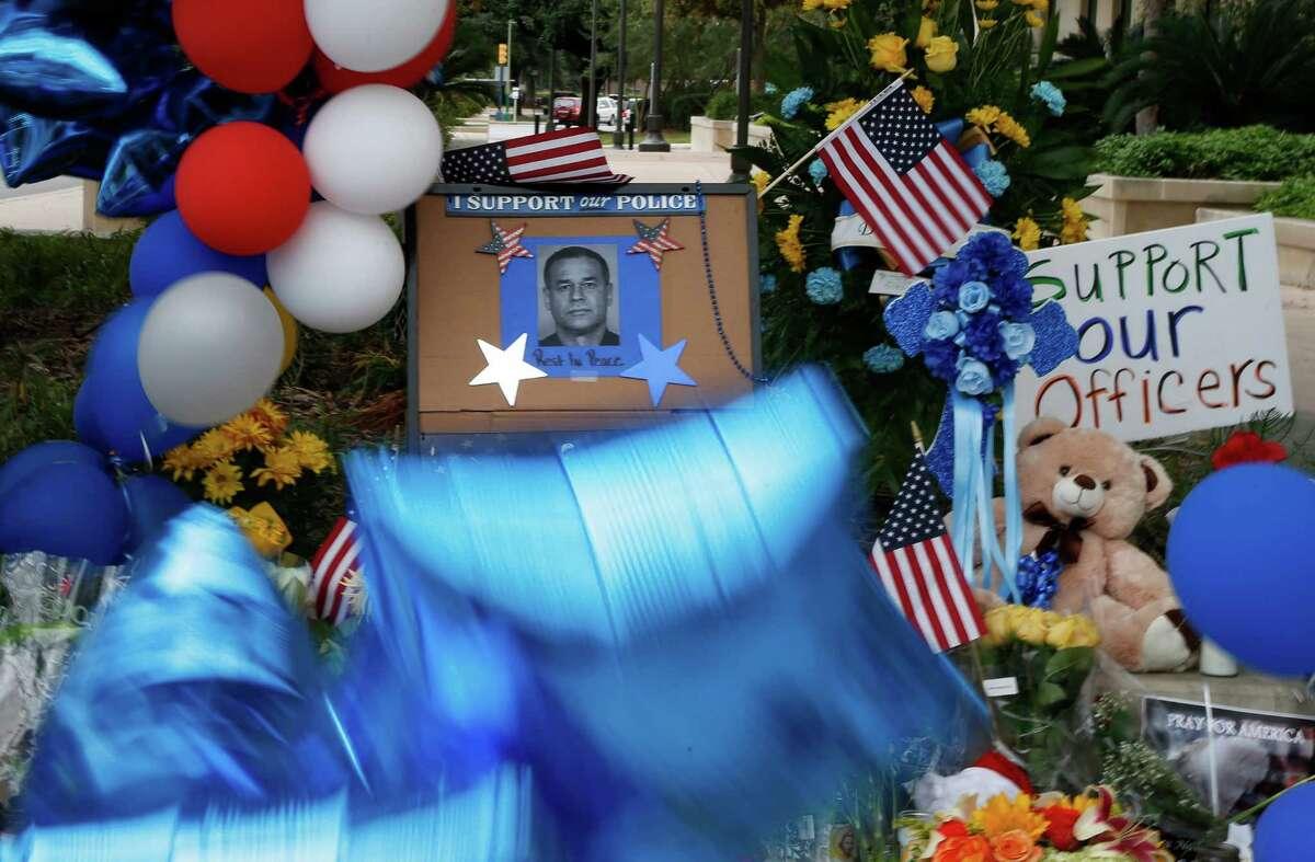 A makeshift memorial to San Antonio Police Det. Benjamin Marconi has sprung up at the San Antonio Police Headquarters.