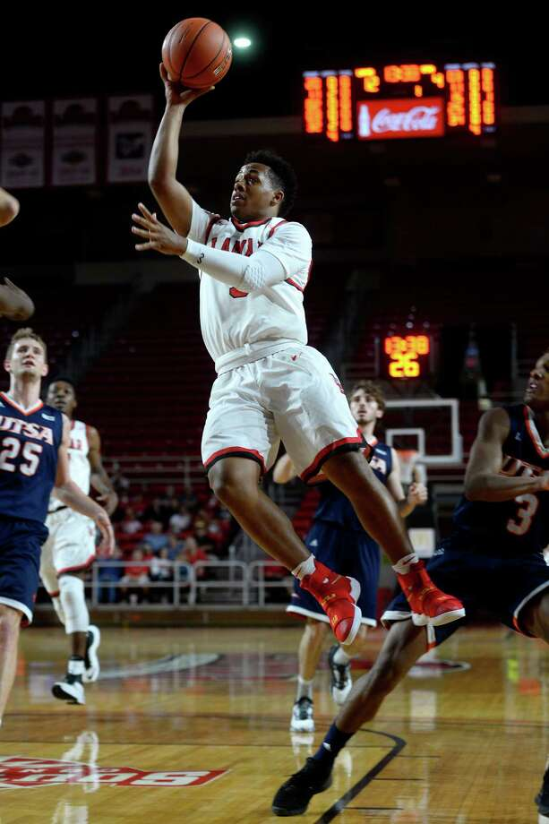 Lamar guard Nick Garth goes airborne shooting against UTSA on Tuesday night.  Photo taken Tuesday 11/22/16 Ryan Pelham/The Enterprise Photo: Ryan Pelham / ©2016 The Beaumont Enterprise/Ryan Pelham