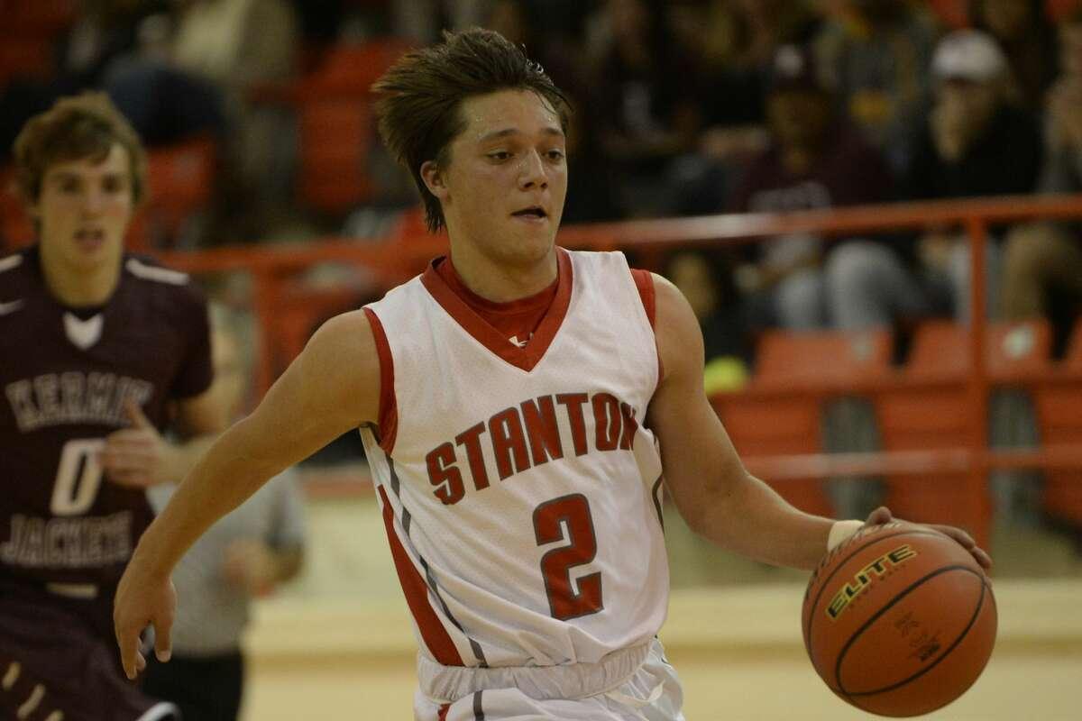 Stanton's Tristen Graves (2) takes the ball down the court against Kermit on Tuesday, Nov. 22, 2016, at Stanton High School. James Durbin/Reporter-Telegram