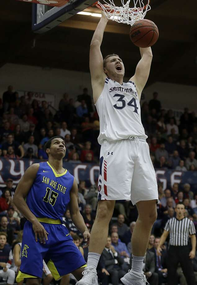 Saint Mary's Jock Landale scores in front of San Jose State's Brandon Clarke (15) during the second half of an NCAA college basketball game Tuesday, Nov. 22, 2016, in Moraga, Calif. (AP Photo/Ben Margot) Photo: Ben Margot, Associated Press