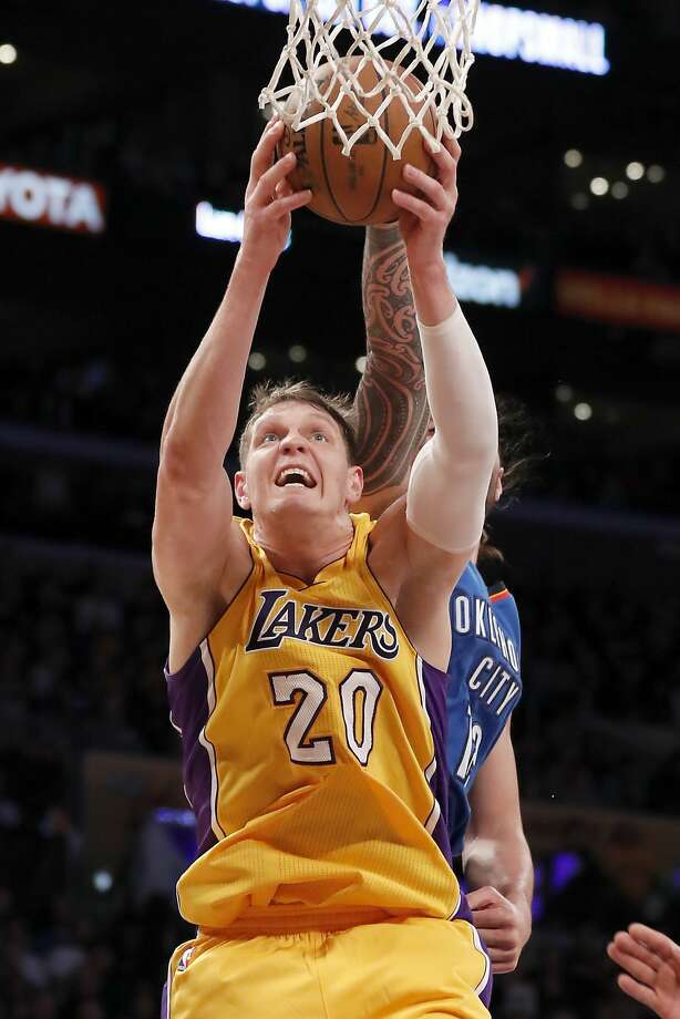 Lakers center Timofey Mozgov grabs a rebound in front of Thunder center Steven Adams. Mozgov had 16 points in the game, and Adams scored 20. Photo: Ryan Kang, Associated Press
