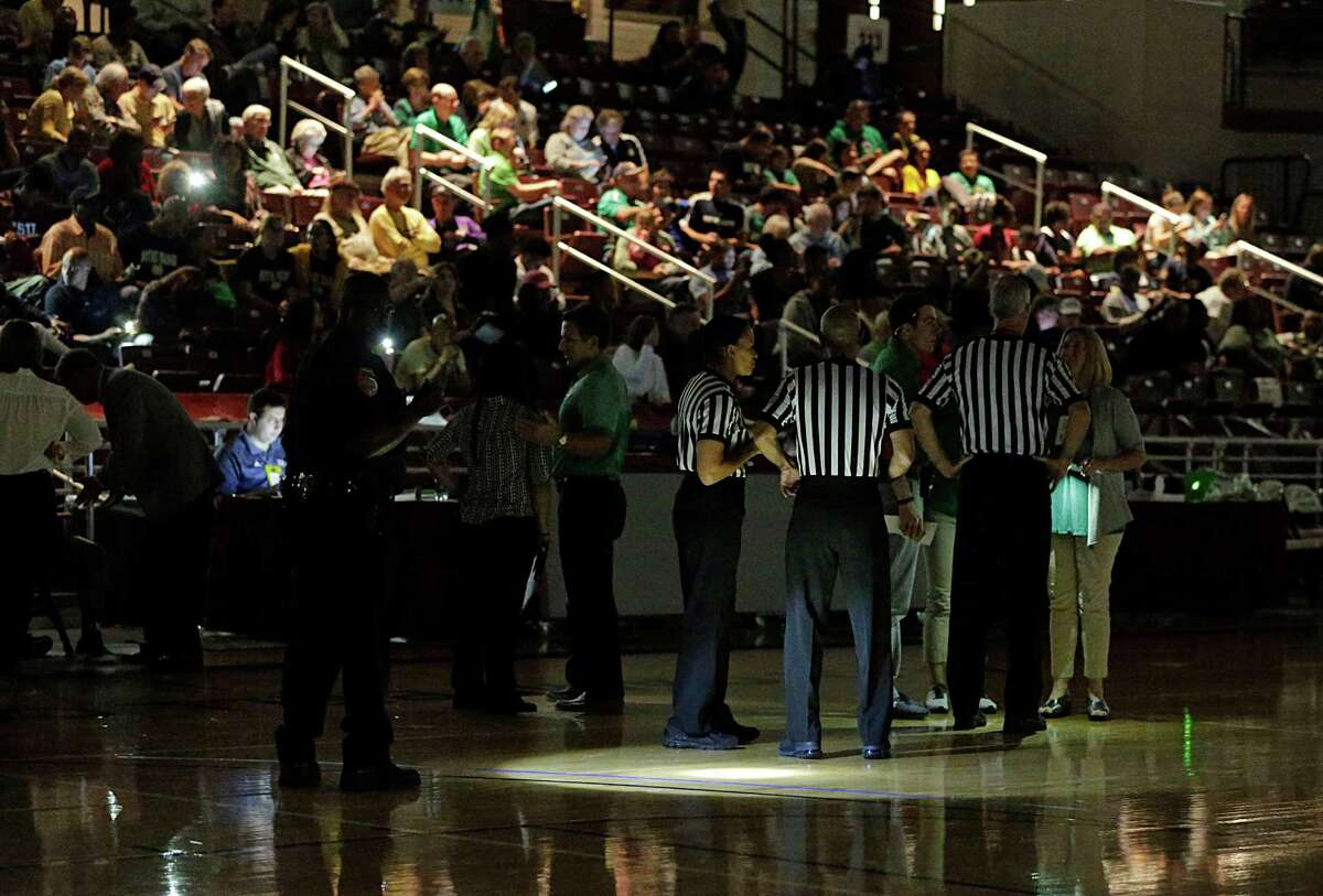 The Campbell Center was nearly dark Tuesday night after a power outage with 2:38 to play in the first half.