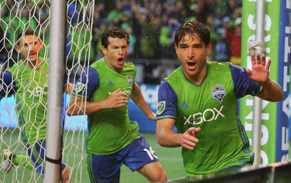 Seattle's Nicolas Lodiero (right), Nelson Valdez and Cristian Roldan celebrate Lodiero's winning goal off a penalty kick during the second half of the first leg of the Western Conference Championship game between the Seattle Sounders and the Colorado Rapids, Tuesday, Nov. 22, 2016 at CenturyLink Field.
