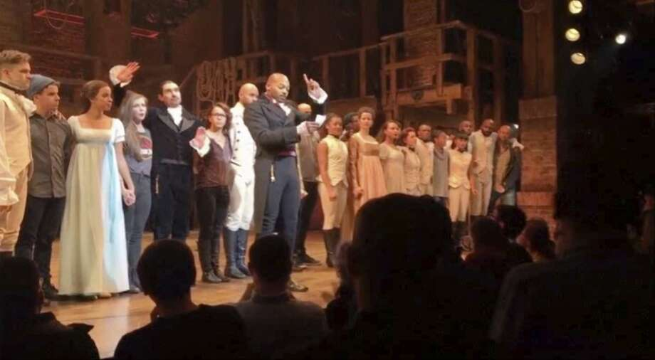 """In this image made from a video provided by Hamilton LLC, actor Brandon Victor Dixon who plays Aaron Burr, the nation�s third vice president, in """"Hamilton"""" speaks from the stage after the curtain call in New York, Friday, Nov. 18, 2016. Vice President-elect Mike Pence is the latest celebrity to attend the Broadway hit """"Hamilton,"""" but the first to get a sharp message from a cast member from the stage. (Hamilton LLC via AP) Photo: Associated Press"""