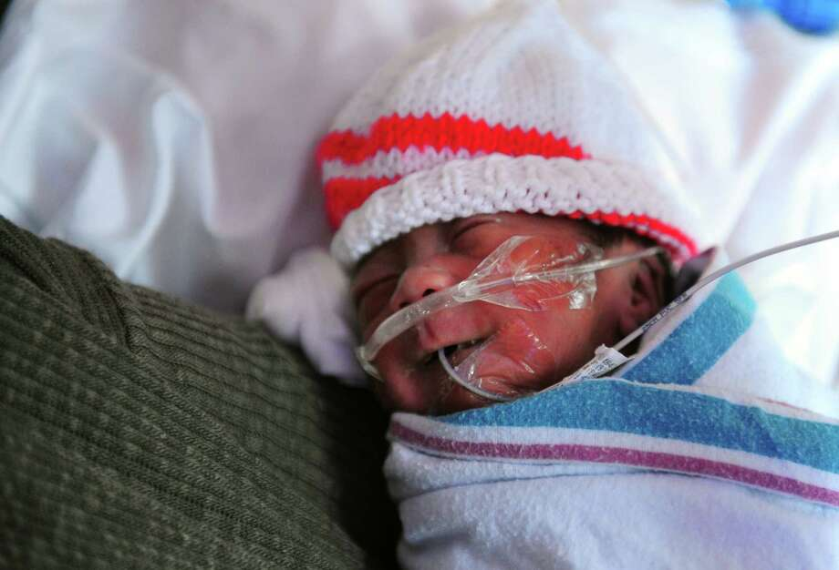 Gavin Jung, born on Oct. 30th at only 27 weeks, rests with his mom Alice Jung, of Stratford, at The Yale New Haven Children's Hospital NICU (neonatal intensive care unit) at Bridgeport Hospital in Bridgeport, Conn. on Tuesday Nov. 22, 2015. The Bridgeport Hospital Foundation has launched a campaign to raise the balance of $7 million to modernize the unit. Photo: Christian Abraham, Hearst Connecticut Media / Connecticut Post