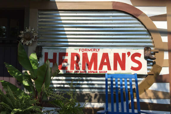 "Kevin Munsterman takes pride in living in a home that used to be  Herman's shoe repair shop. The ""Herman's"" sign still faces the street.  He had to add ""formerly"" to the sign because people were bringing him  their shoes."