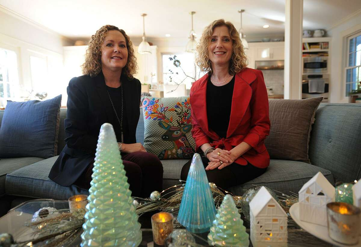 Sisters Mari Flicker, left, and Jennifer Bebon with their Seaglass Beach collection, one of six curated collections of holiday home decorations available from their new business, Holiday In A Box Shop, at Bebon's home in Fairfield on Tuesday.