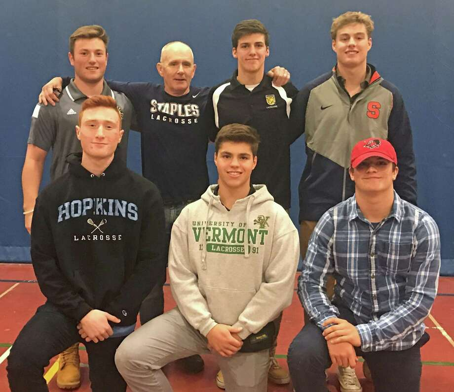 The Staples boys lacrosse team is sending six to play at college. Top row left: Ethan Burger, Wreckers coach Paul McNulty, Billy Hutchison, Tanner Wood. Bottom row left: Evan Zinn, Dobson Cooper, Donny Macaluso. Photo: Ryan Lacey / Hearst Connecticut Media