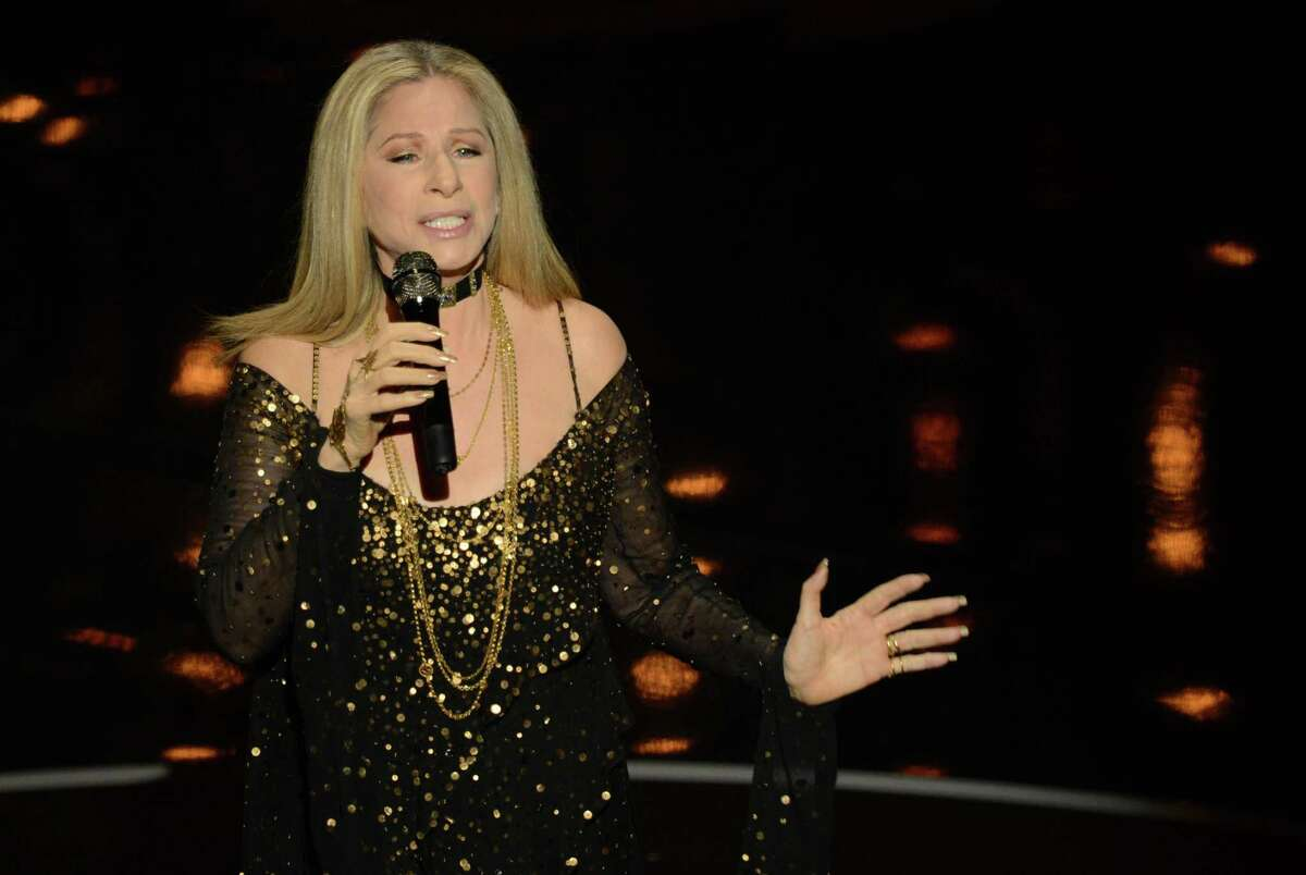 """(FILES) This file photo taken on February 24, 2013 shows singer/actress Barbra Streisand performs onstage at the 85th Annual Academy Awards in Hollywood, California. Barbra Streisand, one of the most enduring US entertainers, on May 16, 2016 announced a new album featuring duets of Broadway musical numbers with Hollywood stars. Streisand revealed the album, entitled """"Encore: Movie Partners Sing Broadway,"""" as she scheduled a tour of North American arenas throughout August in which she will perform some of the songs. The singer's management in a statement did not reveal the release date of the album or her collaborators but said she would sing Broadway classics with """"some of Hollywood's biggest stars."""" / AFP PHOTO / ROBYN BECKROBYN BECK/AFP/Getty Images"""