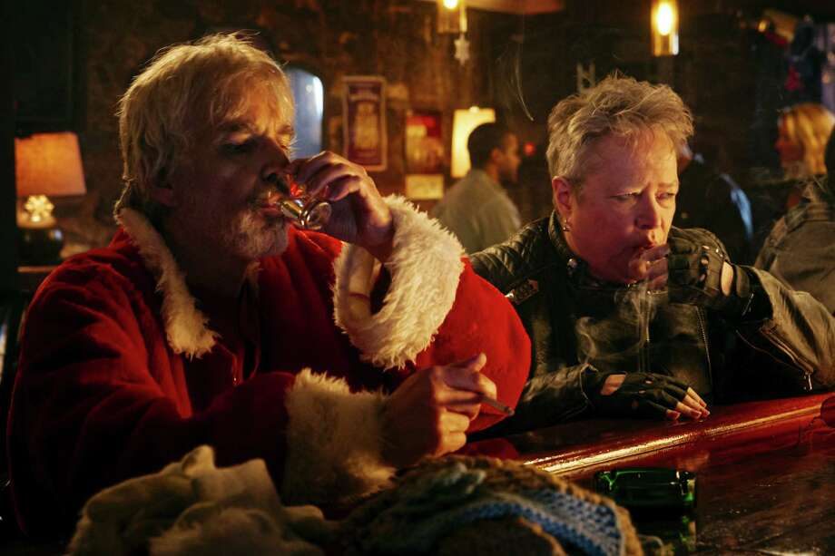 """Drinking in public: Billy Bob Thornton is a very bad Santa with a drinking problem in """"Bad Santa 2."""" Actress Kathy Bates plays his mean, foul-mouthed mother."""