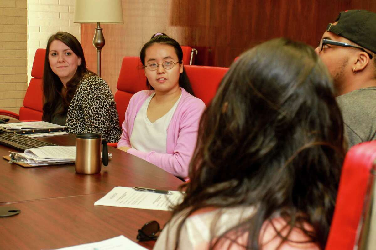 """Elizabeth Gill, left, and Sandra Yan, Ph.D. students in counseling psychology, lead the CAPS (Counseling and Psychological Services) Food for Thought Workshop at the University of Houston. The workshop was titled """"It's All the Rage: Managing Anger."""" (For the Chronicle/Gary Fountain, November 16, 2016)"""