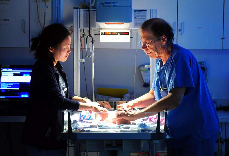Dr. Robert Herzlinger, Director of Neonatology for Yale New Haven Children's Hospital at Bridgeport, works with third year medical student Eun Sook Choi at the hospital's NICU (neonatal intensive care unit) at Bridgeport Hospital in Bridgeport, Conn. on Tuesday Nov. 22, 2015. The Bridgeport Hospital Foundation has launched a campaign to raise the balance of $7 million to modernize the unit. Photo: Christian Abraham, Hearst Connecticut Media
