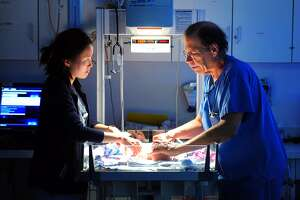 Dr. Robert Herzlinger, Director of Neonatology for Yale New Haven Children's Hospital at Bridgeport, works with third year medical student Eun Sook Choi at the hospital's NICU (neonatal intensive care unit) at Bridgeport Hospital in Bridgeport, Conn. on Tuesday Nov. 22, 2015. The Bridgeport Hospital Foundation has launched a campaign to raise the balance of $7 million to modernize the unit.