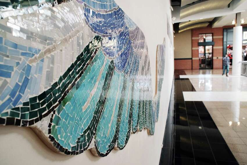 A view of wings covered in stained glass inside Crossgates Mall on Wednesday, Nov. 23, 2016, in Guilderland, N.Y. Artist Tamara DeMartino worked with 28 individuals and staff members of Wildwood to create the wings. (Paul Buckowski / Times Union)