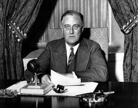 FILE --  President Franklin D. Roosevelt prepares to begin his first fireside chat to the American people in this March 12, 1933 file photo. Speaking to the nation on radio from the White House in Washington, Roosevelt explained in simple langauge the measures he was taking to solidify the nation's shaky banking system.  Roosevelt had been in office less than 100 days.  (AP Photo/File)