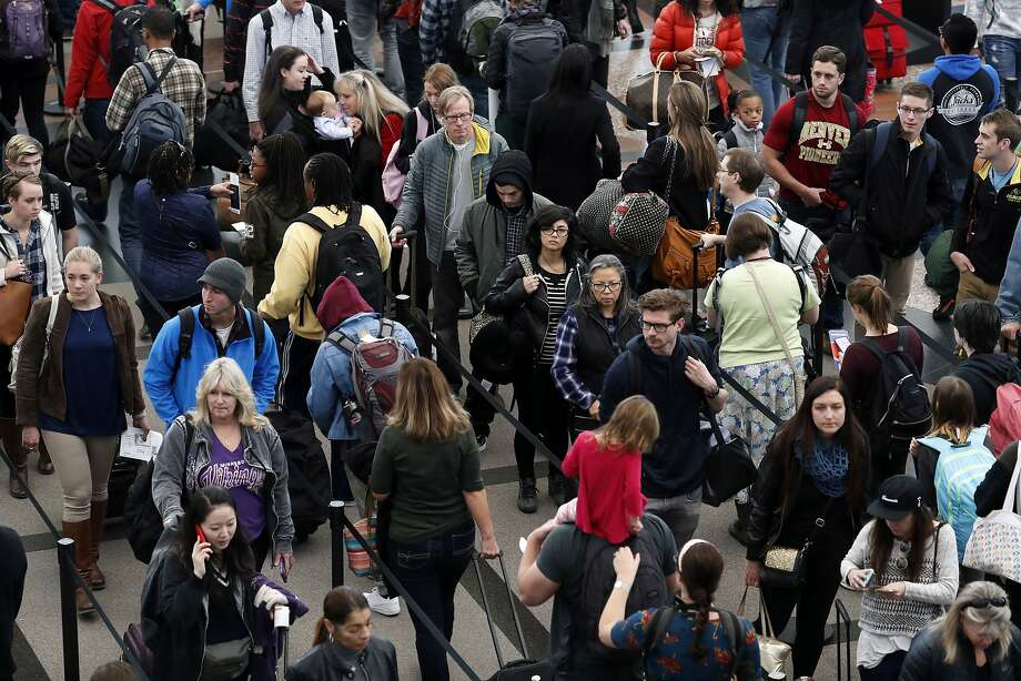 Travelers are criss-crossing the country, clogging airport terminals like this one at Denver International Airport. Photo: David Zalubowski, Associated Press