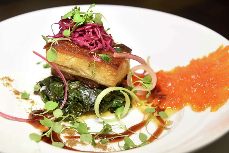 Belly of the Beast is house-cured maple-smoked belly of pork with carrot jam, house-made greek yogurt, pickled red cabbage, baby radish and cumin port wine jus on Thursday, Nov 16, 2016, at Rascal's Steakhouse in Guilderland, N.Y. (Cindy Schultz / Times Union) Photo: Cindy Schultz / Albany Times Union
