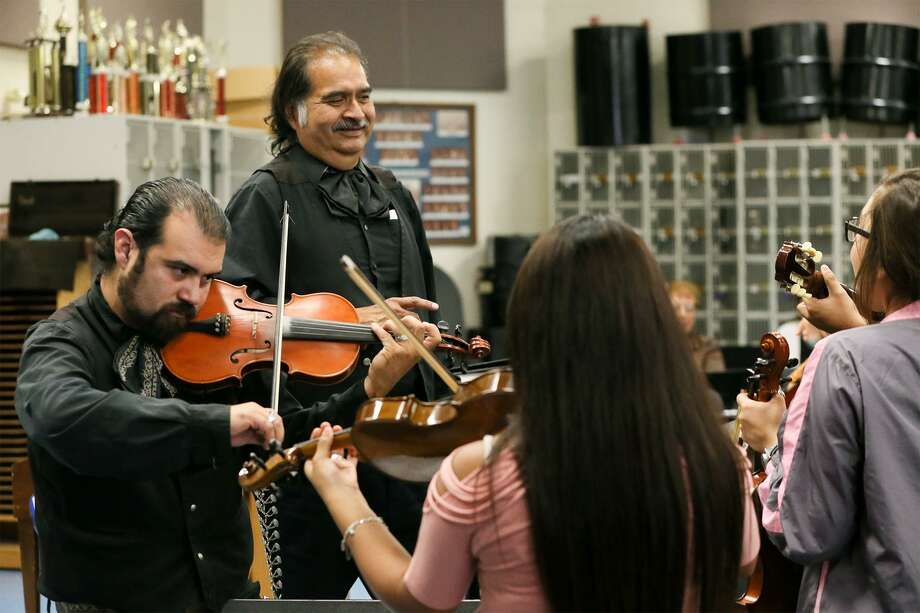 South San head Mariachi instructor Peter Leo Moreno (left) and his father, Pete Moreno, will perform with Mariachi Los Parientes and some mariachi students at the annual dinner. Photo: Marvin Pfeiffer /San Antonio Express-News / Express-News 2016