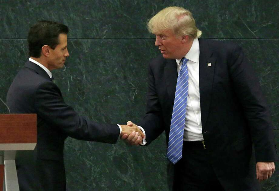 Mexico President Enrique Pena Nieto and Republican presidential nominee Donald Trump shake hands after a joint statement at Los Pinos, the presidential official residence, in Mexico City, Wednesday, Aug. 31, 2016. Trump is calling his surprise visit to Mexico City Wednesday a 'great honor.' The Republican presidential nominee said after meeting with Pena Nieto that the pair had a substantive, direct and constructive exchange of ideas.v(AP Photo/Marco Ugarte) Photo: Marco Ugarte, STF / Copyright 2016 The Associated Press. All rights reserved.