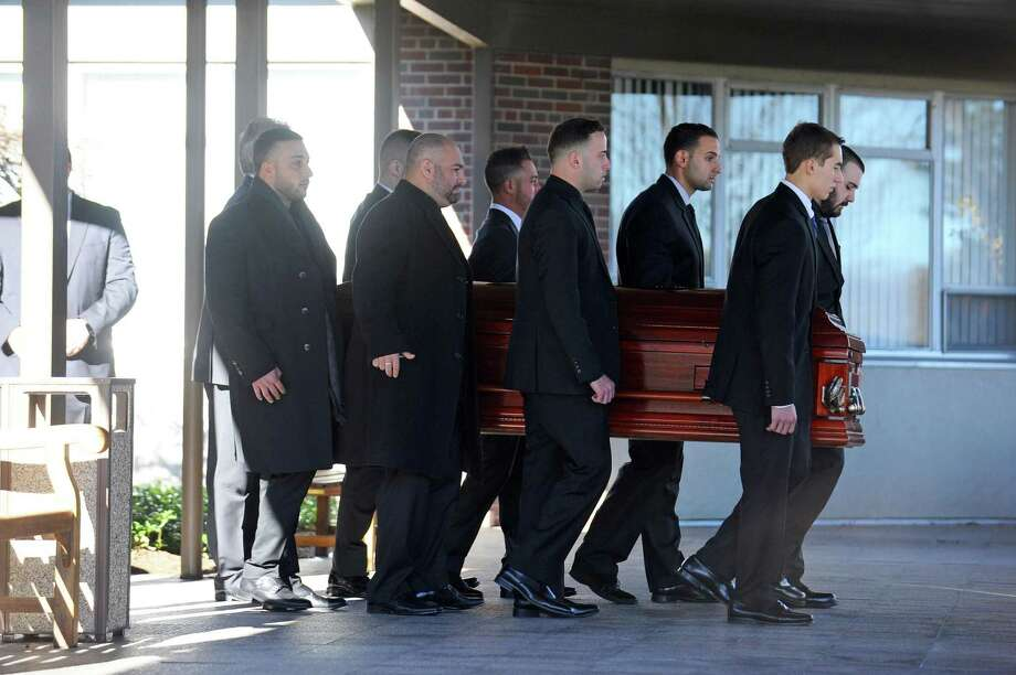 """Pallbearers carry the casket of Joseph """"Joey"""" Comunale following his funeral at St. Leo's Church in Stamford. Photo: Michael Cummo / Hearst Connecticut Media / Stamford Advocate"""