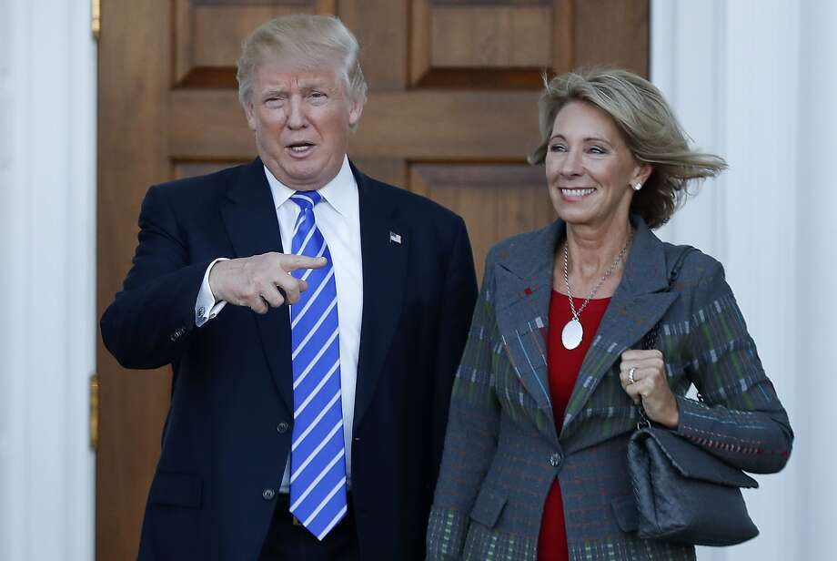 FILE - In this Nov. 19, 2016 file photo, President-elect Donald Trump and Betsy DeVos pose for photographs at Trump National Golf Club Bedminster clubhouse in Bedminster, N.J. Trump has chosen charter school advocate DeVos as Education Secretary in his administration. (AP Photo/Carolyn Kaster, File) Photo: Carolyn Kaster, Associated Press