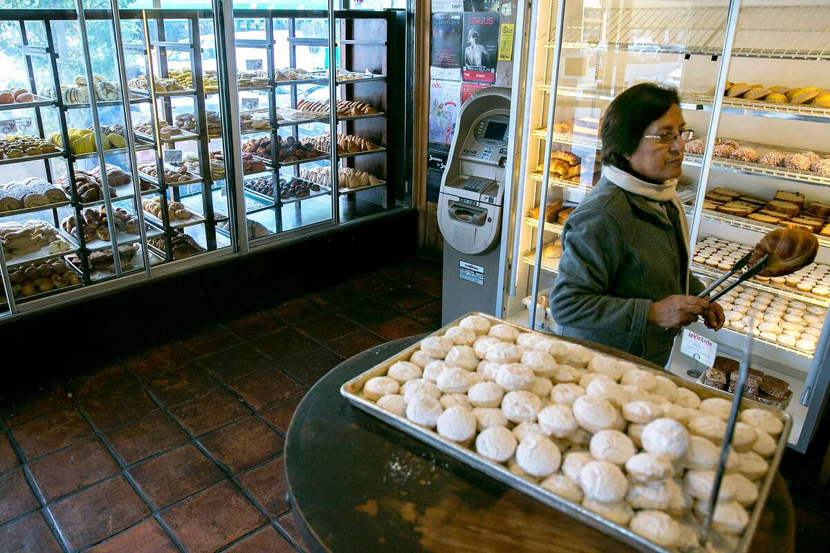 Luz Rioja, who is visiting from Peru, grabs a bread, at La Victoria, a bakery, on Tuesday, Nov. 22, 2016 in San Francisco, Calif. Rioja said she always buys bread here when she visits from Peru.