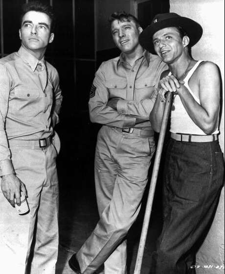 """Frank Sinatra, right, stands with fellow actors Montgomery Cliff, left, and Burt Lancaster in this scene from the film """"From Here to Eternity."""" Sinatra's performance won him an Oscar as best supporting actor in 1953. (AP Photo/Files) Photo: AP"""