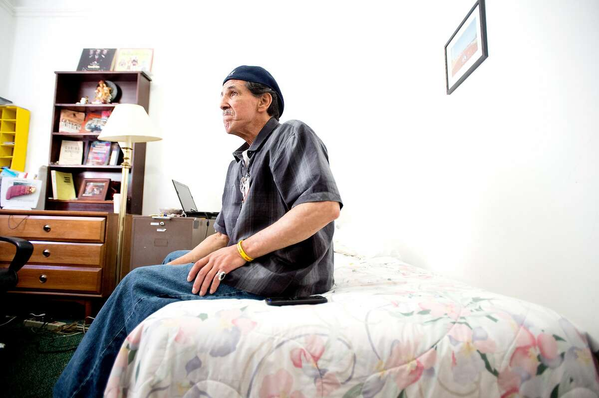 Orlando Chavez sits on his bed at the Travelers Hotel in Oakland, Calif., on Monday, Oct. 10, 2016. The century-old SRO (single-room-occupancy) hotel is being converted into market-rate housing for young professionals leaving current tenants with an uncertain future.