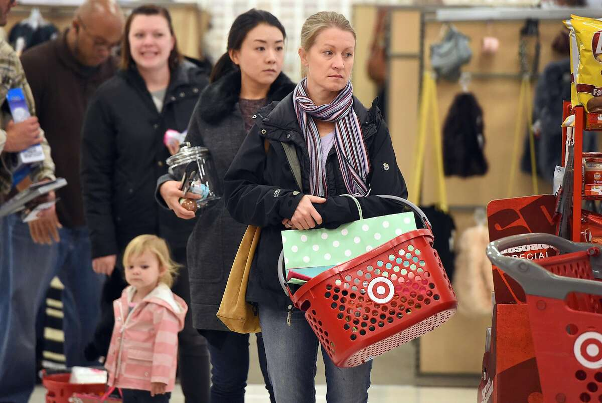 Laura Scriba (R) waits in line at a Target store in Emeryville, Calif. on November 19, 2016.