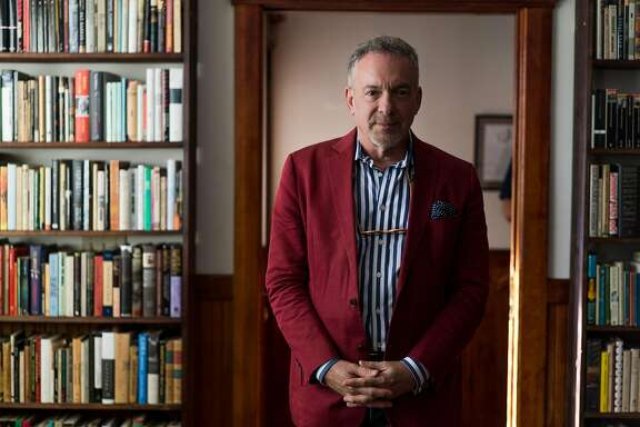 Publisher Steve Wasserman poses for a photograph at Heyday Books in Berkeley, Calif. on Wednesday, Nov. 9, 2016. Wasserman is the new publisher of Heyday Books and the offices are filled with more than 15,000 of his own books.