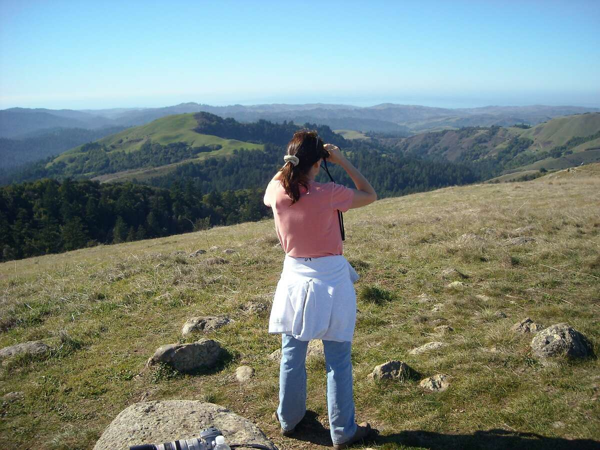 Susan Vance takes in long-distance view from Borel Hill at Windy Hill Open Space Preserve on Peninsula Photo courtesy Tom Vance