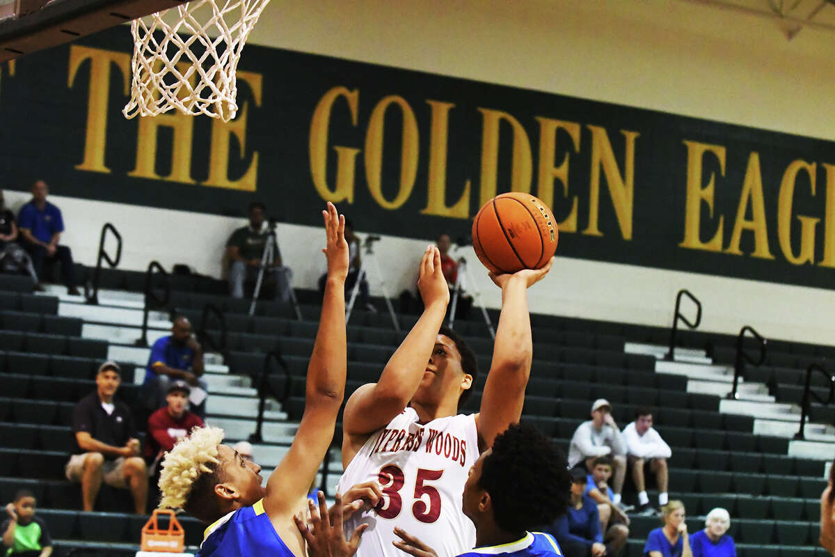 Cy Woods sophomore forward Noah Smith puts up a shot against Klein Tuesday morning at the Border Battle. Smith was one of the more impressive Wildcats, putting up nine points and logging three impactful blocks throughout the contest.