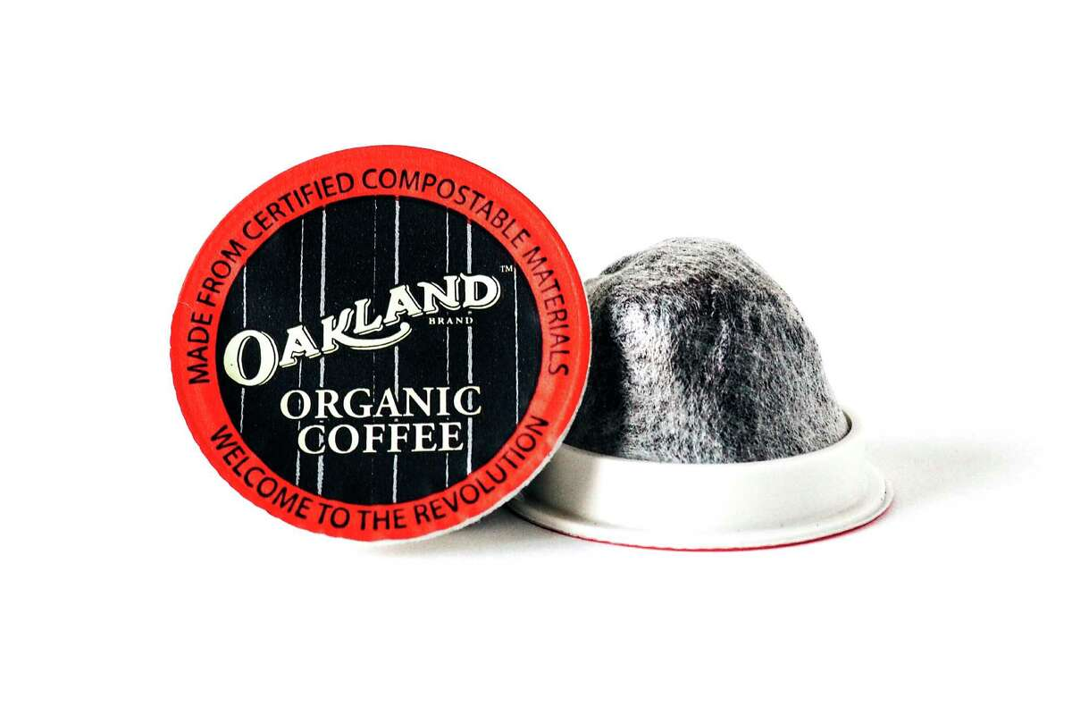 This undated photo provided by Oakland Coffee Works shows a soft, single-serve coffee pod from Oakland Coffee Works that is fully compostable. The Oakland, California, company owned by Green Day's Billie Joe Armstrong and Mike Dirnt partnered with the San Francisco Bay Coffee Co. to develop the pods using organic, fairly traded beans from Peru and Honduras. (Yasamine June/Oakland Coffee Works via AP) ORG XMIT: NYLS430
