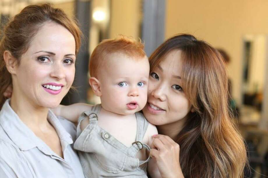 Cristina Vomoca, left, and Maiko Kobayashi are stylists at a Greenwich hair salon who suffered severe injuries in a collision on Arch Street this weekend. Oliver is the son of Vomoca. Photo: / Contributed
