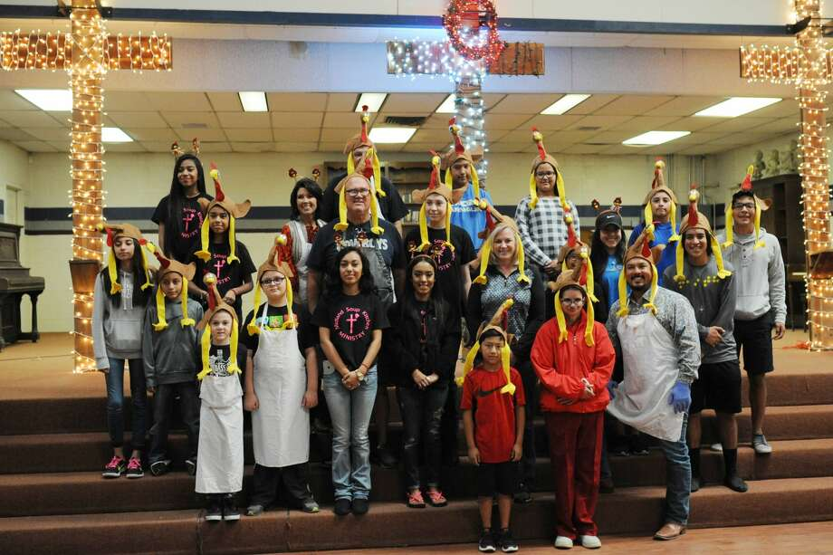 Superb Volunteers Pose For A Photo Before The Start Of A Free Thanksgiving Meal  For The Community Pictures